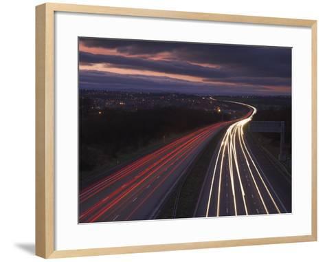 Traffic Light Trails in the Evening on the M1 Motorway Near Junction 28, Derbyshire, England, UK-Neale Clarke-Framed Art Print