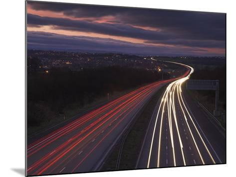 Traffic Light Trails in the Evening on the M1 Motorway Near Junction 28, Derbyshire, England, UK-Neale Clarke-Mounted Photographic Print