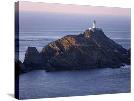 Muckle Flugga and its Lighthouse, Hermaness Nature Reserve, Unst, Shetland Islands, Scotland-Patrick Dieudonne-Stretched Canvas Print