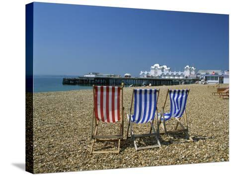 Empty Deck Chairs on the Beach and the Southsea Pier, Southsea, Hampshire, England, United Kingdom-Nigel Francis-Stretched Canvas Print