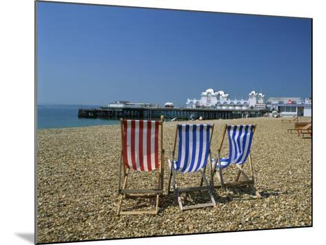 Empty Deck Chairs on the Beach and the Southsea Pier, Southsea, Hampshire, England, United Kingdom-Nigel Francis-Mounted Photographic Print