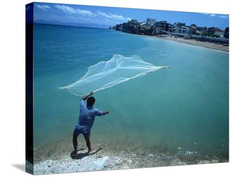 Fisherman with Net, Kupang, Timor, Southeast Asia-Robert Francis-Stretched Canvas Print