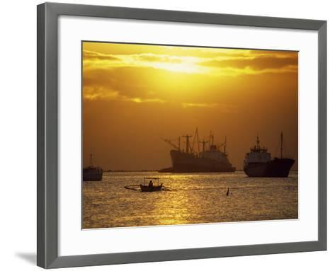 Cargo Ships and Outrigger Canoe in Manila Bay at Sunset, in the Philippines, Southeast Asia-Robert Francis-Framed Art Print