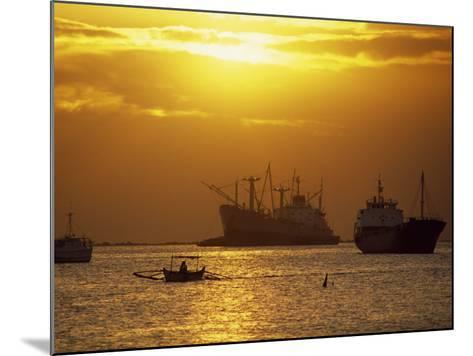 Cargo Ships and Outrigger Canoe in Manila Bay at Sunset, in the Philippines, Southeast Asia-Robert Francis-Mounted Photographic Print