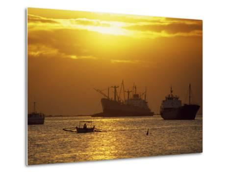 Cargo Ships and Outrigger Canoe in Manila Bay at Sunset, in the Philippines, Southeast Asia-Robert Francis-Metal Print