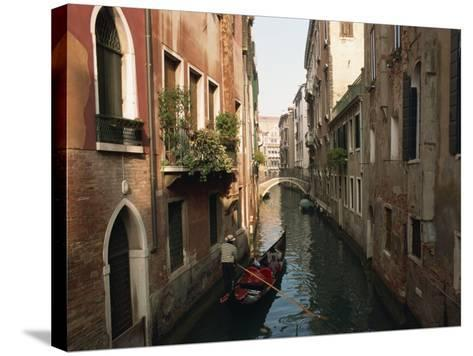 Gondolas on a Canal Near Piazza San Maria Formosa. Venice, Veneto, Italy, Europe-Lee Frost-Stretched Canvas Print