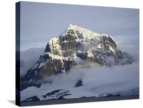 Snow Covered Coastal Mountain, Wiencke Island, Antarctic Peninsula, Antarctica, Polar Regions-James Hager-Stretched Canvas Print