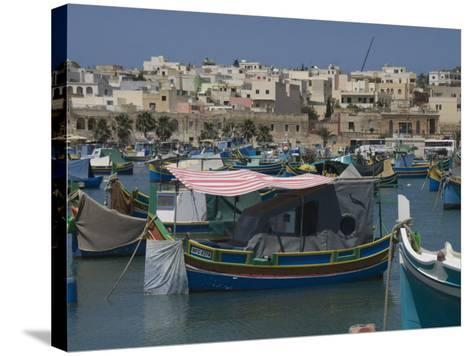Brightly Coloured Fishing Boats Called Luzzus at the Fishing Village of Marsaxlokk, Malta-Robert Harding-Stretched Canvas Print