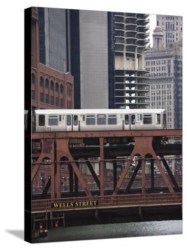 An El Train on the Elevated Train System Crossing Wells Street Bridge, Chicago, Illinois, USA-Amanda Hall-Stretched Canvas Print