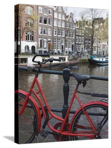 Red Bicycle by the Herengracht Canal, Amsterdam, Netherlands, Europe-Amanda Hall-Stretched Canvas Print