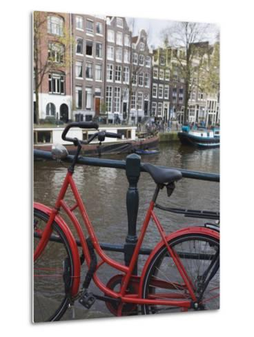 Red Bicycle by the Herengracht Canal, Amsterdam, Netherlands, Europe-Amanda Hall-Metal Print