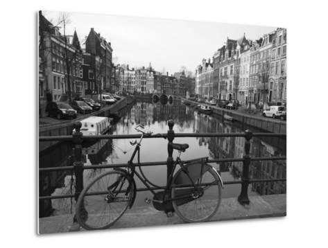 Black and White Imge of an Old Bicycle by the Singel Canal, Amsterdam, Netherlands, Europe-Amanda Hall-Metal Print