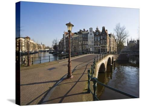 Bridge over the Keizersgracht Canal, Amsterdam, Netherlands, Europe-Amanda Hall-Stretched Canvas Print