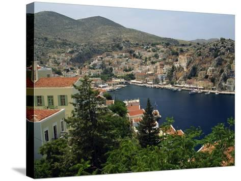 View over the Harbour and Town of Yialos on the Coast, Symi, Dodecanese Islands, Greece-Fraser Hall-Stretched Canvas Print