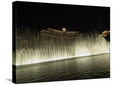 Bellagio Hotel at Night with its Famous Fountains, the Strip, Las Vegas, Nevada, USA-Robert Harding-Stretched Canvas Print