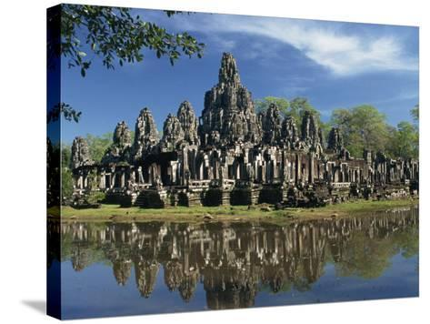 Bayon Temple Reflected in Water at Angkor, Siem Reap, Cambodia, Indochina, Southeast Asia-Gavin Hellier-Stretched Canvas Print