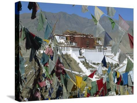 Potala Palace, UNESCO World Heritage Site, Seen Through Prayer Flags, Lhasa, Tibet, China-Gavin Hellier-Stretched Canvas Print