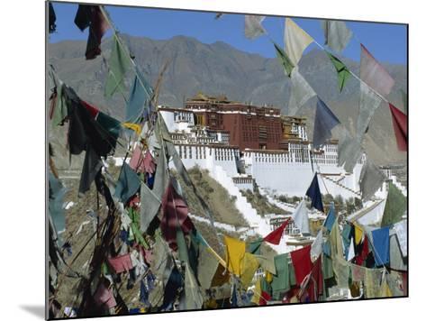 Potala Palace, UNESCO World Heritage Site, Seen Through Prayer Flags, Lhasa, Tibet, China-Gavin Hellier-Mounted Photographic Print