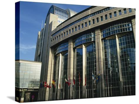 Flags Outside the European Commission and Parliament Buildings in Brussels, Belgium, Europe-David Hughes-Stretched Canvas Print