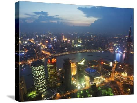Bund and the Oriental Pearl Tower Illuminated in Pudong New Area, Pudong, Shanghai, China-Kober Christian-Stretched Canvas Print
