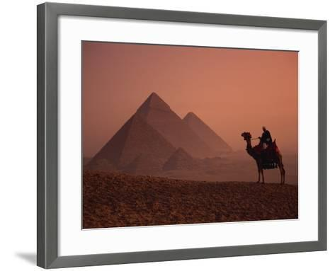Camel and Rider at Giza Pyramids, UNESCO World Heritage Site, Giza, Cairo, Egypt-Howell Michael-Framed Art Print