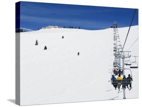 Skiers Being Carried on a Chair Lift to the Back Bowls of Vail Ski Resort, Vail, Colorado, USA-Kober Christian-Stretched Canvas Print