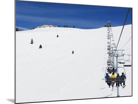 Skiers Being Carried on a Chair Lift to the Back Bowls of Vail Ski Resort, Vail, Colorado, USA-Kober Christian-Mounted Photographic Print
