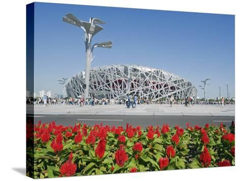 Flowers and the Birds Nest National Stadium in the Olympic Green, Beijing, China-Kober Christian-Stretched Canvas Print