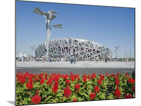 Flowers and the Birds Nest National Stadium in the Olympic Green, Beijing, China-Kober Christian-Mounted Photographic Print