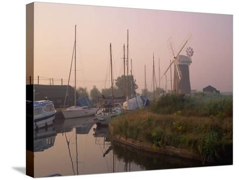Horsey Wind Pump and Boats Moored on the Norfolk Broads at Dawn, Norfolk, England, United Kingdom-Miller John-Stretched Canvas Print