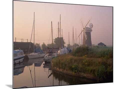 Horsey Wind Pump and Boats Moored on the Norfolk Broads at Dawn, Norfolk, England, United Kingdom-Miller John-Mounted Photographic Print