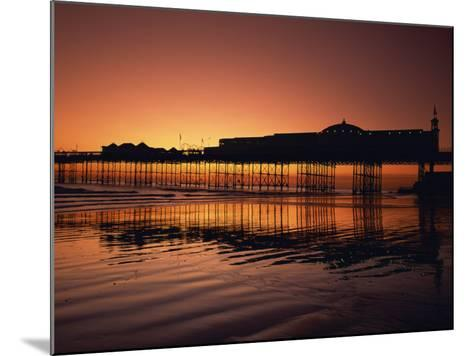 Reflections in the Sea of the Pier at Brighton at Sunset, Sussex, England, United Kingdom, Europe-Rainford Roy-Mounted Photographic Print