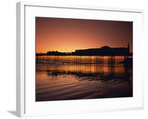 Reflections in the Sea of the Pier at Brighton at Sunset, Sussex, England, United Kingdom, Europe-Rainford Roy-Framed Art Print
