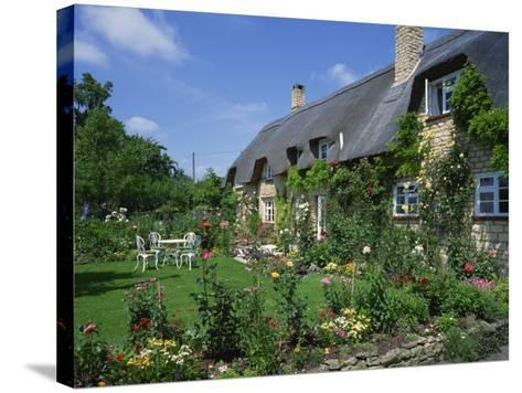Thatched Cottages in the Cotswolds, Gloucestershire, England, UK-Rainford Roy-Stretched Canvas Print
