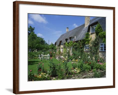 Thatched Cottages in the Cotswolds, Gloucestershire, England, UK-Rainford Roy-Framed Art Print