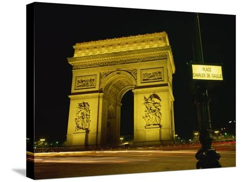 Place Charles De Gaulle Street Sign and the Arc De Triomphe Illuminated at Night, Paris, France-Rainford Roy-Stretched Canvas Print