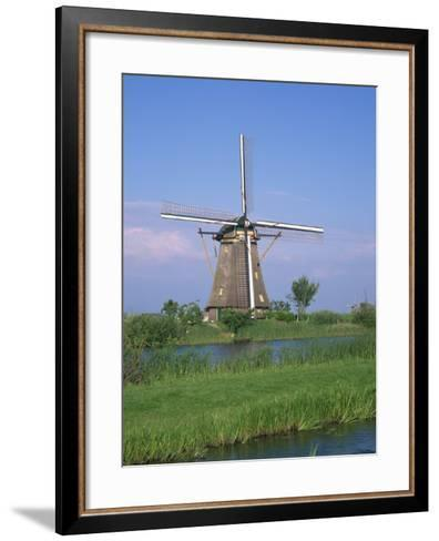 Thatched Windmills on the Canal at Kinderdijk, UNESCO World Heritage Site, Holland, Europe-Rainford Roy-Framed Art Print