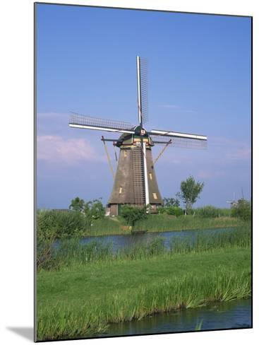 Thatched Windmills on the Canal at Kinderdijk, UNESCO World Heritage Site, Holland, Europe-Rainford Roy-Mounted Photographic Print
