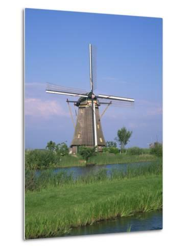 Thatched Windmills on the Canal at Kinderdijk, UNESCO World Heritage Site, Holland, Europe-Rainford Roy-Metal Print