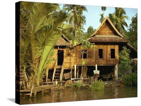 Traditional Thai House on Stilts Above the River in Bangkok, Thailand, Southeast Asia-Sassoon Sybil-Stretched Canvas Print