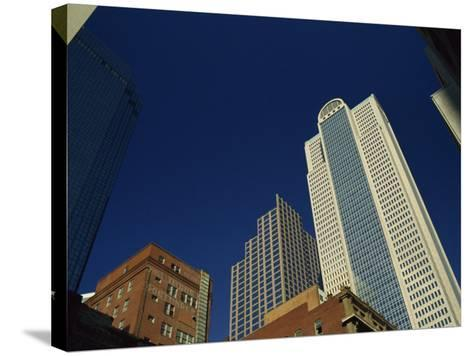 Old Brick Building Contrasts with Modern Skyscrapers in Dallas, Texas, USA-Rennie Christopher-Stretched Canvas Print