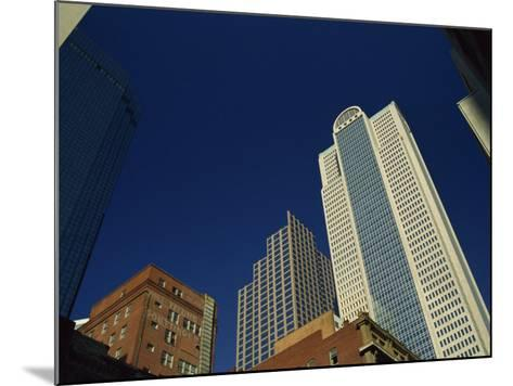 Old Brick Building Contrasts with Modern Skyscrapers in Dallas, Texas, USA-Rennie Christopher-Mounted Photographic Print