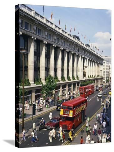 Selfridges and Old Routemaster Bus before They Were Withdrawn, Oxford Street, London, England-Rawlings Walter-Stretched Canvas Print