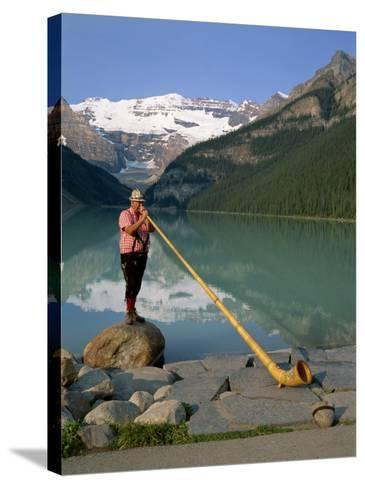 Man with an Alpenhorn Beside Lake Louise in the Banff National Park, Alberta, Canada, North America-Renner Geoff-Stretched Canvas Print