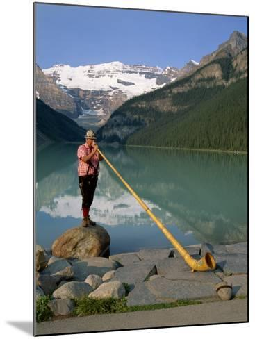 Man with an Alpenhorn Beside Lake Louise in the Banff National Park, Alberta, Canada, North America-Renner Geoff-Mounted Photographic Print