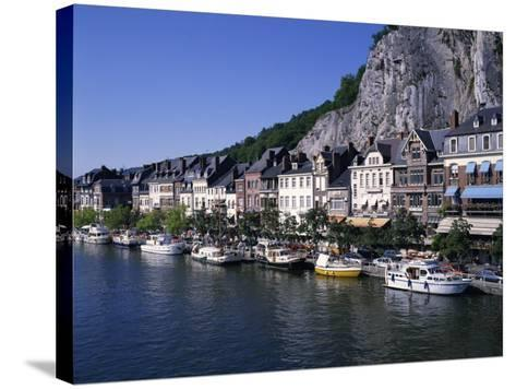 Boats Line the Waterfront on the River Meuse in the Old Town of Dinant in the Ardennes, Belgium-Hans Peter Merten-Stretched Canvas Print