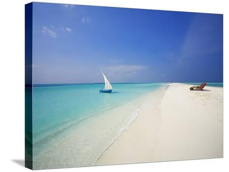Dhoni and Lounge Chairs on Tropical Beach, Maldives, Indian Ocean-Papadopoulos Sakis-Stretched Canvas Print