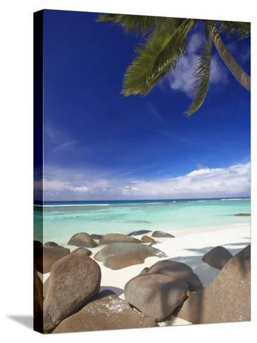Rocks and Palm Tree on Tropical Beach, Seychelles, Indian Ocean, Africa-Papadopoulos Sakis-Stretched Canvas Print