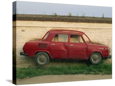 Half a Skoda on a Wall in a Car Salesyard Near Piestany, Slovakia, Europe-Strachan James-Stretched Canvas Print