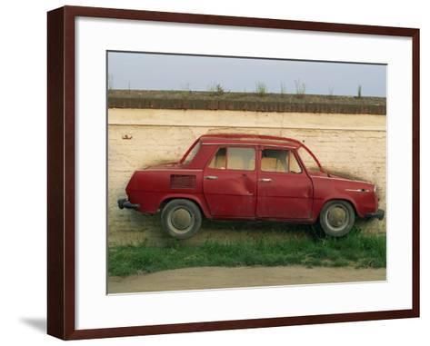 Half a Skoda on a Wall in a Car Salesyard Near Piestany, Slovakia, Europe-Strachan James-Framed Art Print